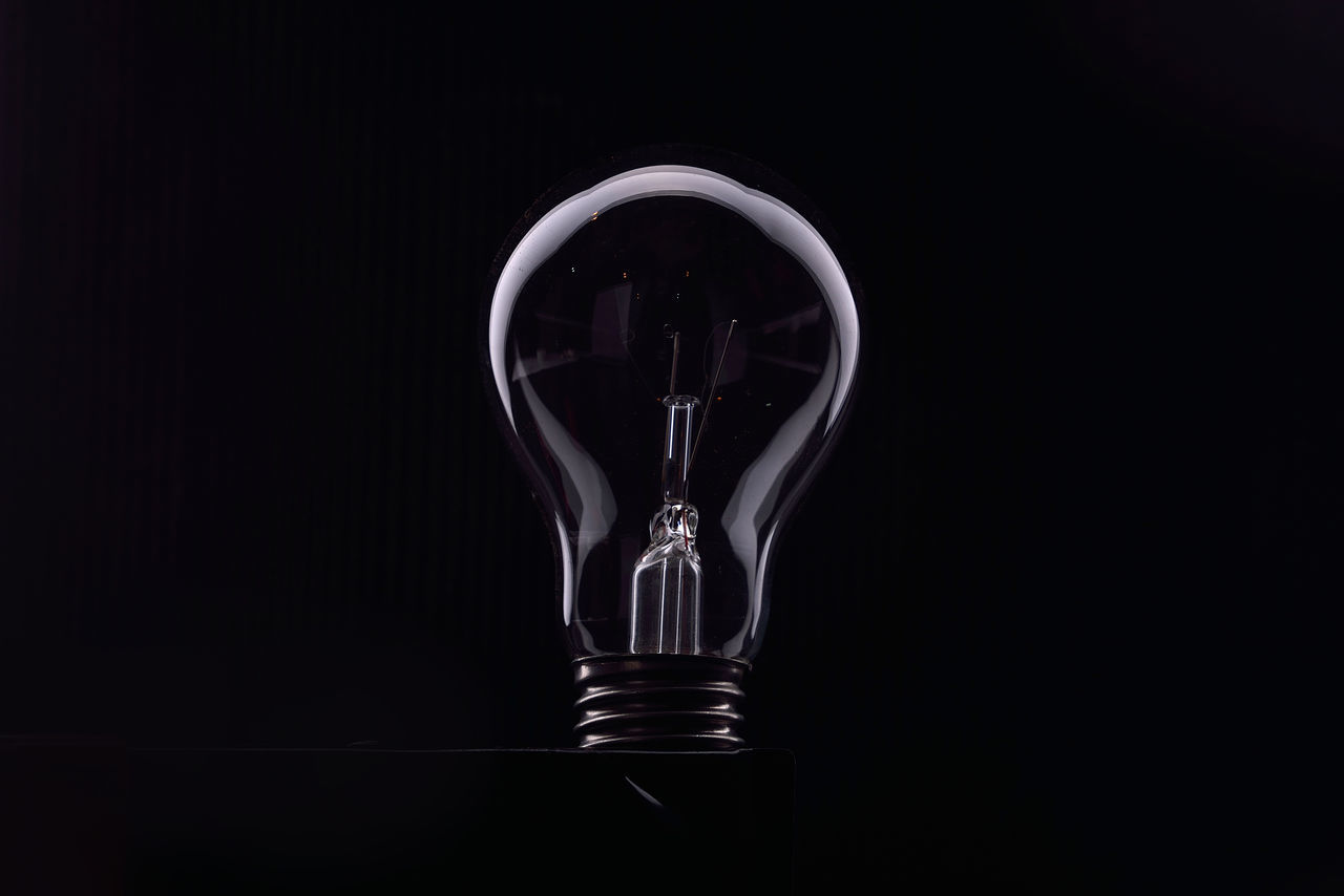 light bulb, electricity, black background, studio shot, filament, copy space, fuel and power generation, no people, illuminated, close-up, day