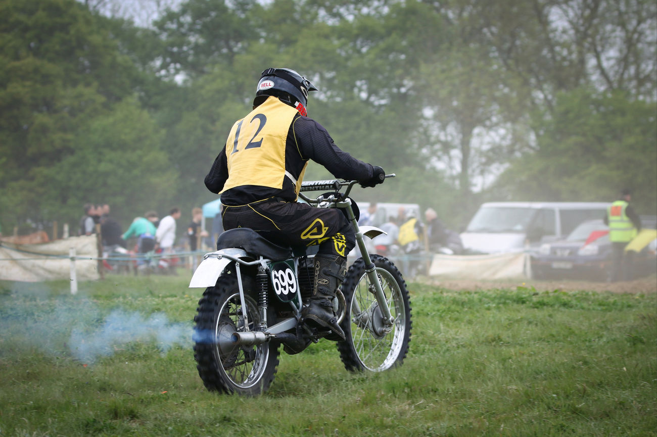 Motocross Rider Adventure Biker Day Full Length Grass Headwear Helmet Land Vehicle Lifestyles Men Mode Of Transport Motion Motorcycle Nature One Person Outdoors Real People Rear View Riding Road Sport Sports Helmet Sports Race Transportation Tree