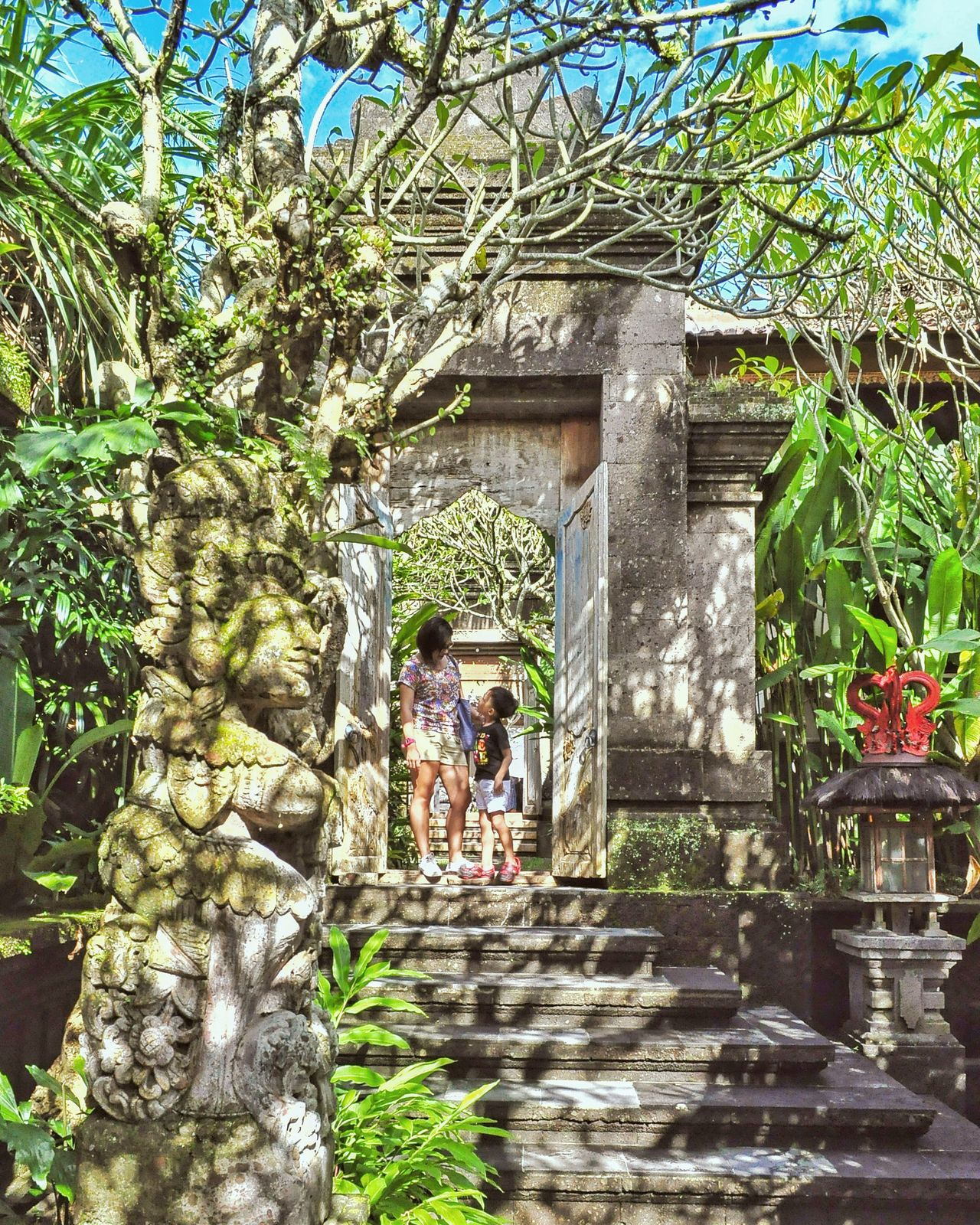 Tree Building Exterior Architecture Outdoors Day Sculpture Mom And Son Vacations Happiness Togetherness Tree Travel Bali Garden Ubud Tranquility