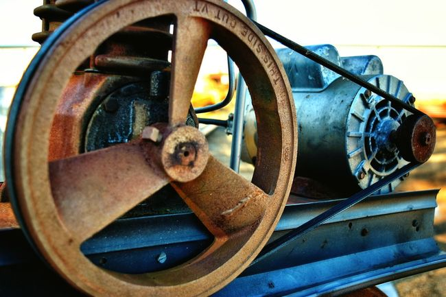 Metal At Work Industrial Metal Work No People Machine Shop Machine Wheel Close-up Equipment Belts And Pulleys Round Rusted