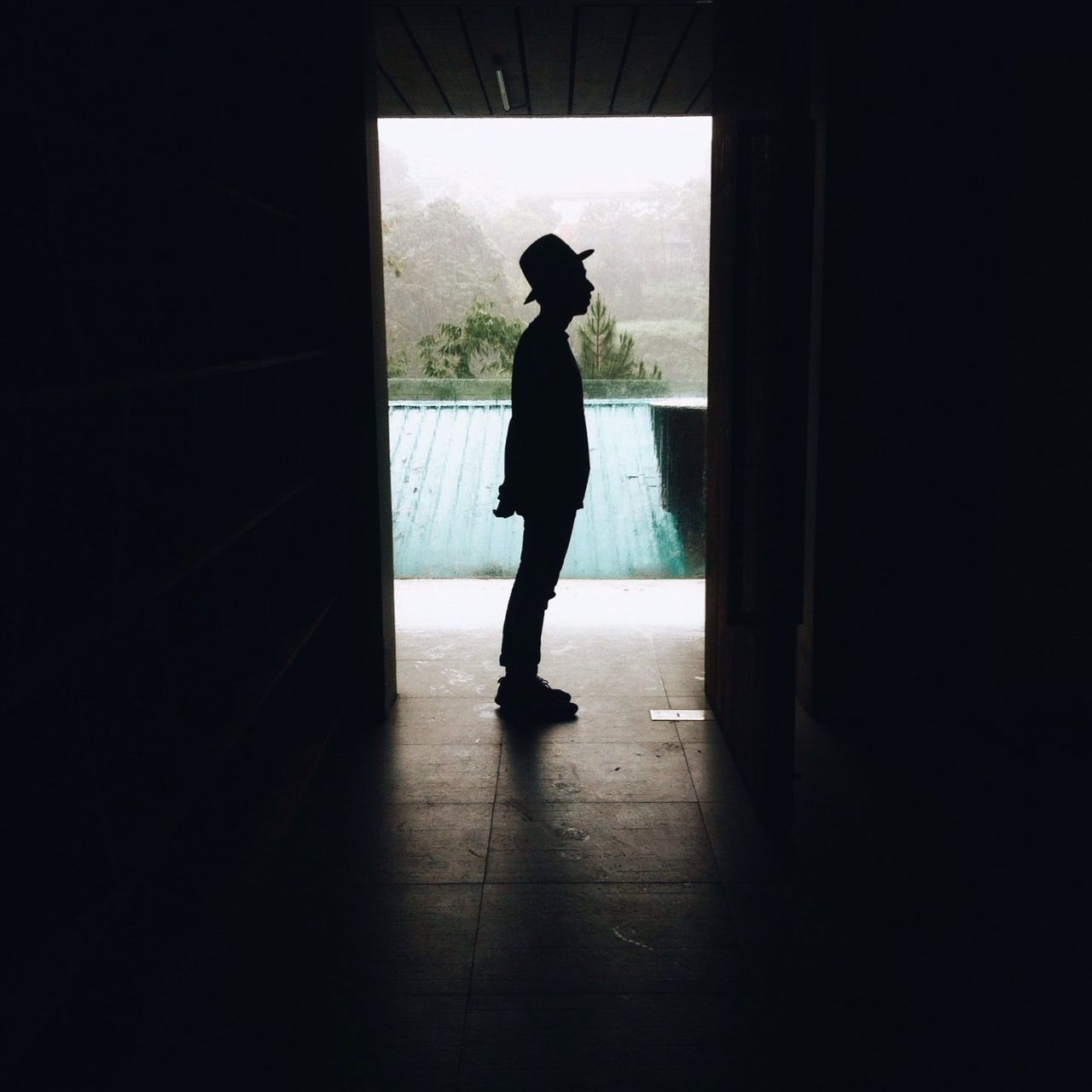 indoors, one person, full length, window, silhouette, real people, standing, lifestyles, women, day, open door, young adult, people