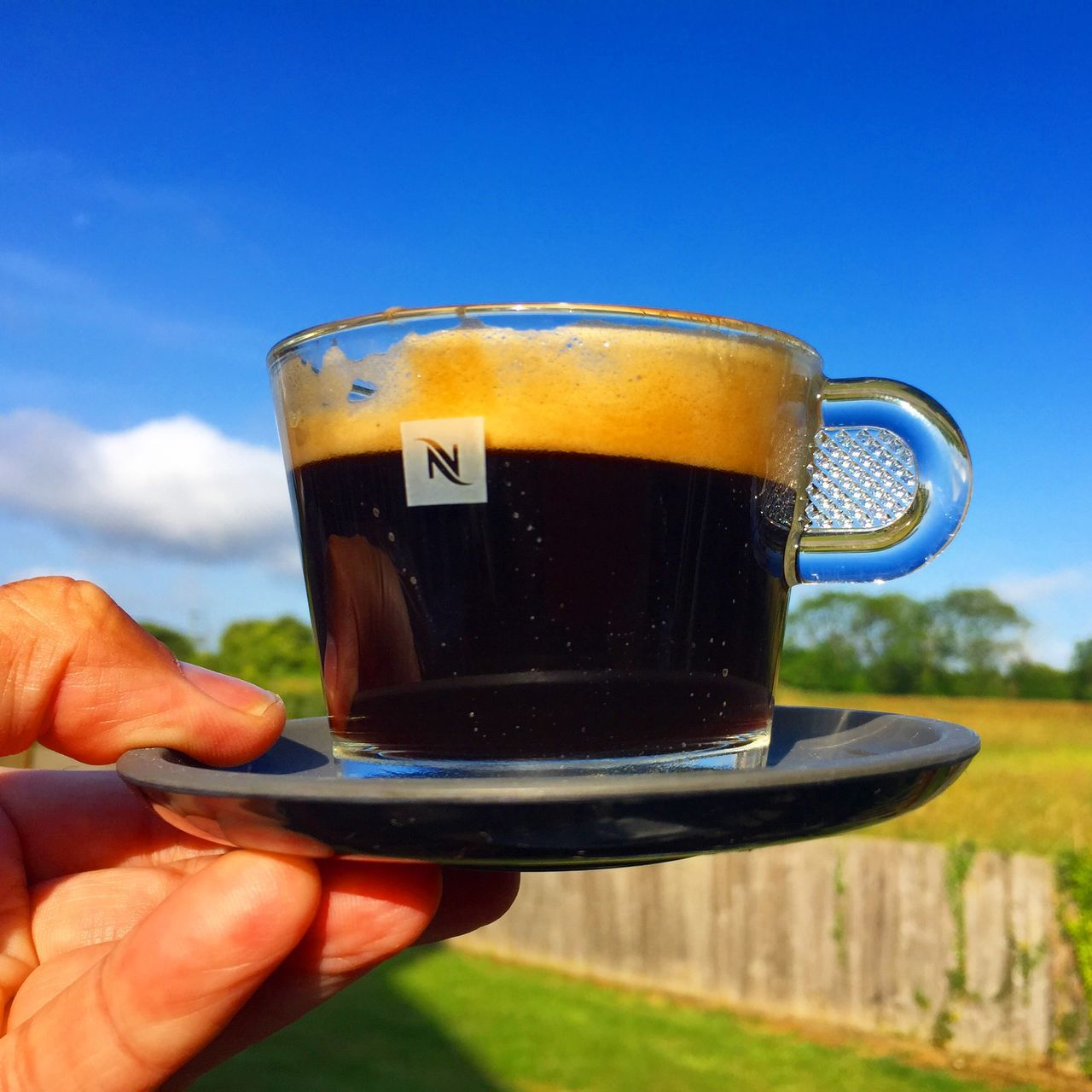 Nespresso coffee in a glass cup in the sun in Northamptonshire Coffee Northamptonshire Nespresso Nespresso Time Nespresso Time!!! Nespressomoments I Love Nespresso Coffee Time Coffee Break Coffee At Home Breakfast Coffee ☕ Coffeebreak Drinking Coffee Northampton Northamptonshire Sun Weather