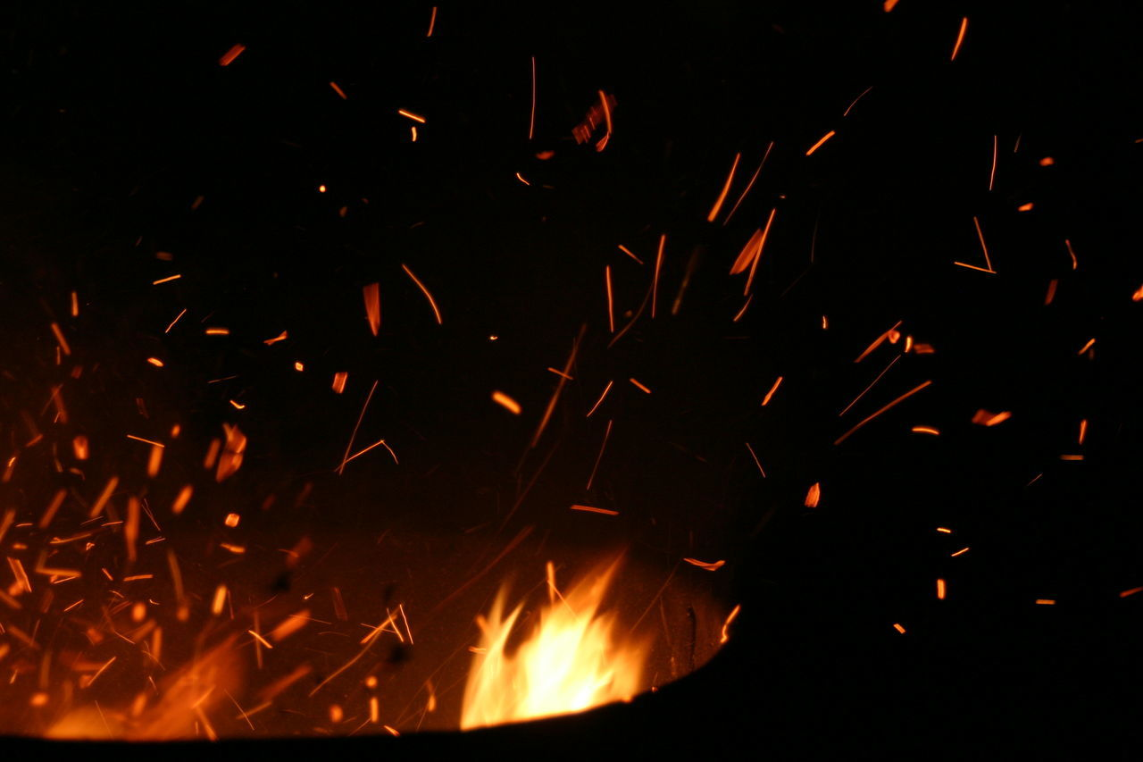 Burning Close-up Fire Nature Night No People Outdoors Sparks Sparks Fly Sparks Flying