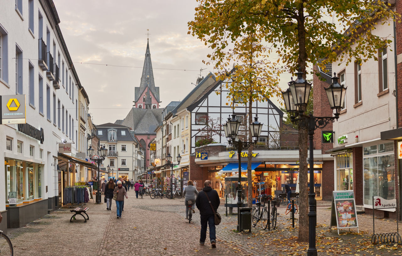 KEMPEN, GERMANY - OCTOBER 26, 2016: Unidentified shoppers populate the central shopping street. Atmospheric Mood Christanity Colorful Downtown Germany Heritage High Resolution Historic City History Light Love Market Medieval Outdoors People Relaxing Shopping Travel Destination Urban