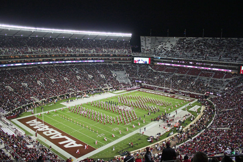 University of Alabama Million Dollar Band spelling UA during homecoming show. Bama Crimson Tide  Crowd Football Halftime High Angle View Large Group Of People Marching Band Million Dollar Band Outdoors Playing Field Pregame Spectator Sport Sports Stadium University Of Alabama The Color Of Sport