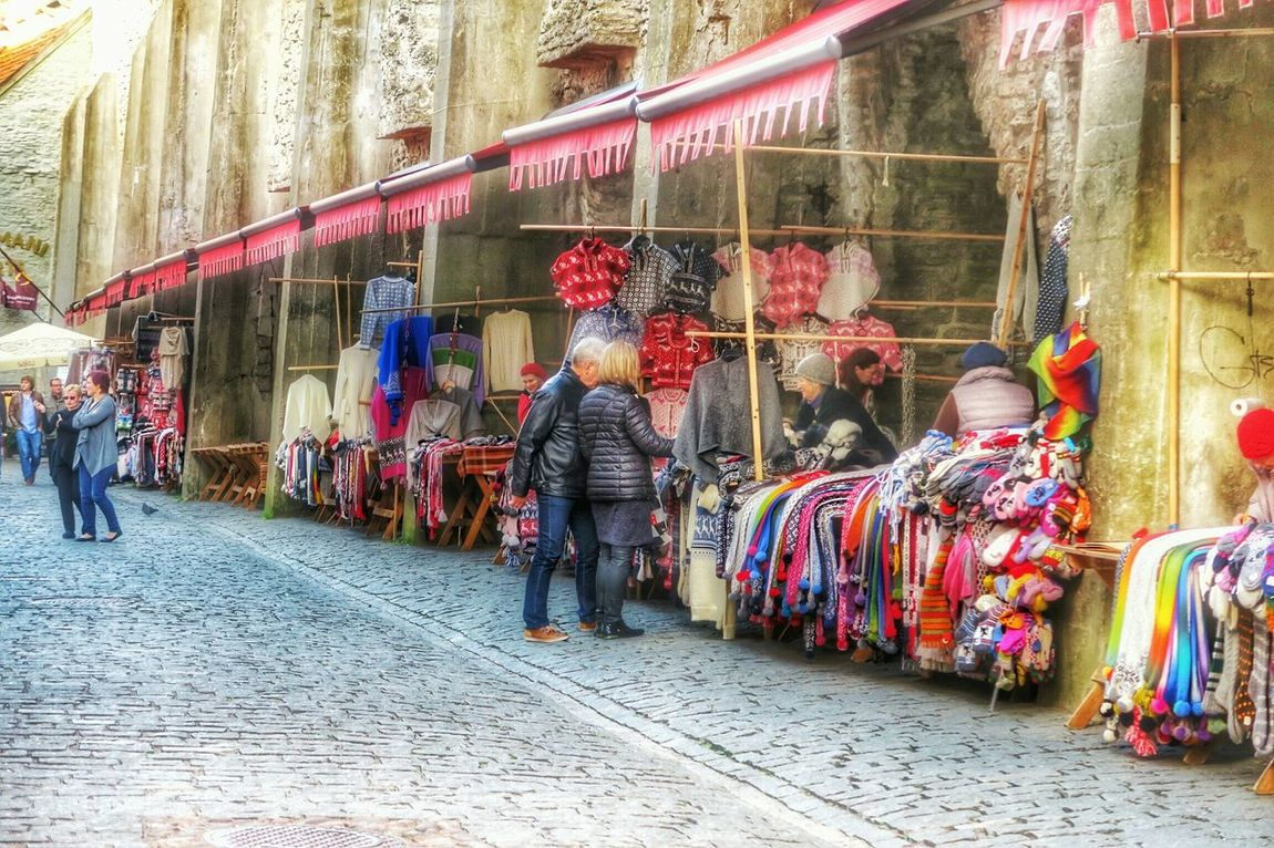 Browsing the market Tallinn Estonia Baltic Medieval Architecture G7x October2015 Cobblestones Market Arts And Crafts People Watching Steetphotography