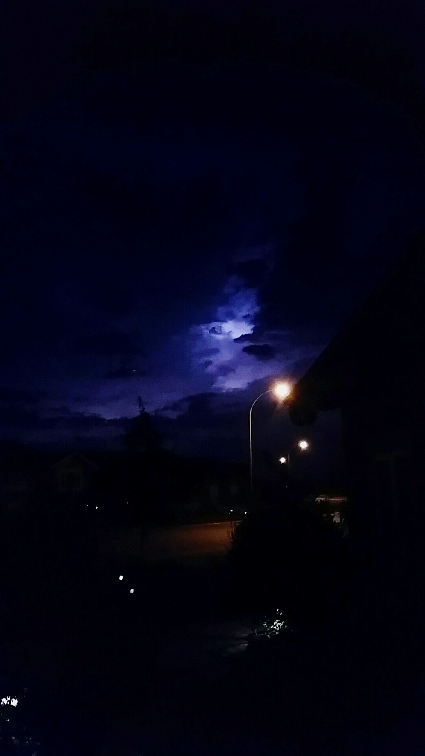 night, sky, illuminated, dark, built structure, building exterior, cloud - sky, silhouette, architecture, dusk, weather, cloudy, street light, nature, outdoors, city, storm cloud, scenics, beauty in nature, no people