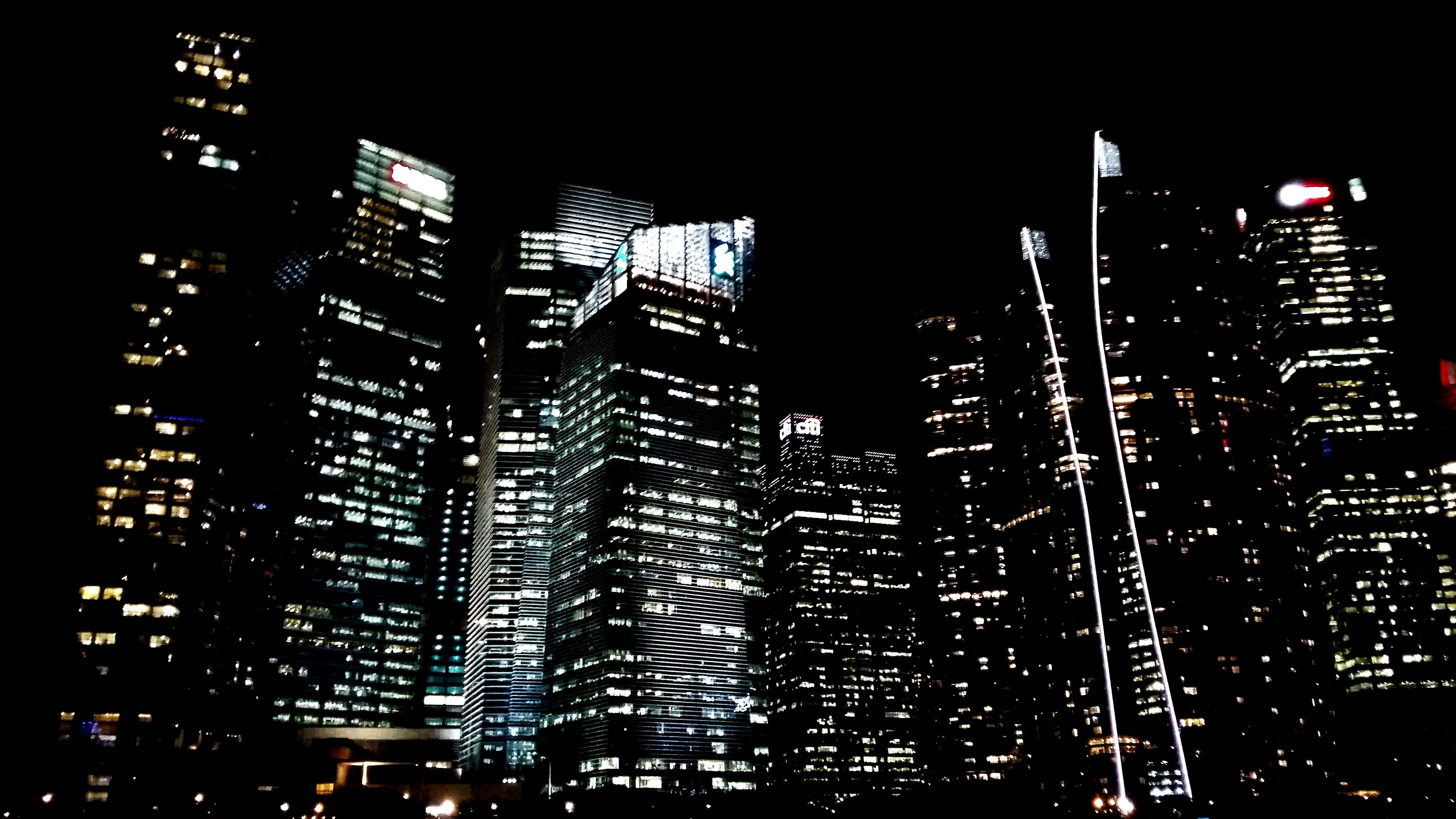 night, illuminated, architecture, building exterior, city, built structure, skyscraper, modern, office building, building, low angle view, dark, tall - high, cityscape, tower, no people, window, residential building, outdoors, sky