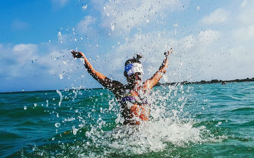 Limb Human Limb Sea Wave Only Men Human Arm Motion Adults Only Young Adult Beach Splashing Human Body Part Sky One Man Only Adult One Person Outdoors Challenge People Cloud - Sky One Woman Only Young Women Summer Happiness Lifestyles Women Around The World