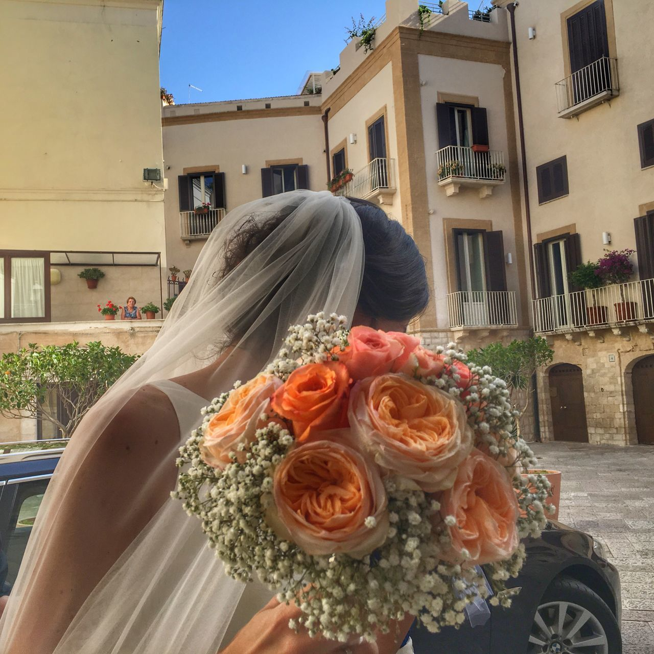 flower, bouquet, wedding, bride, wedding dress, real people, rose - flower, building exterior, life events, built structure, architecture, one person, celebration, women, day, lifestyles, outdoors, close-up, freshness, groom, bridegroom, people