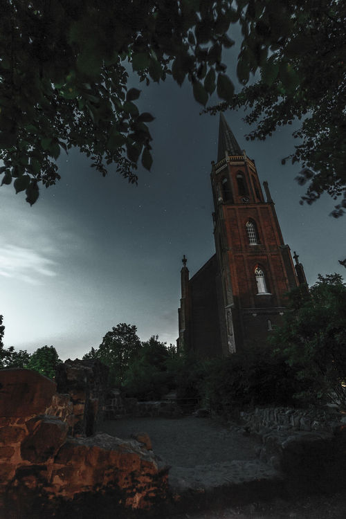 moonlight church Architecture Building Exterior Cities At Night Castle Cathedral Cathedral Church Clear Sky Cross Darkness Darkness And Light Gothic Gothic Architecture History Low Angle View Moonshot The Mix Up Place Of Worship Religion Scary The Architect - 2016 EyeEm Awards Spirituality Steeple Tower Tree The Secret Spaces