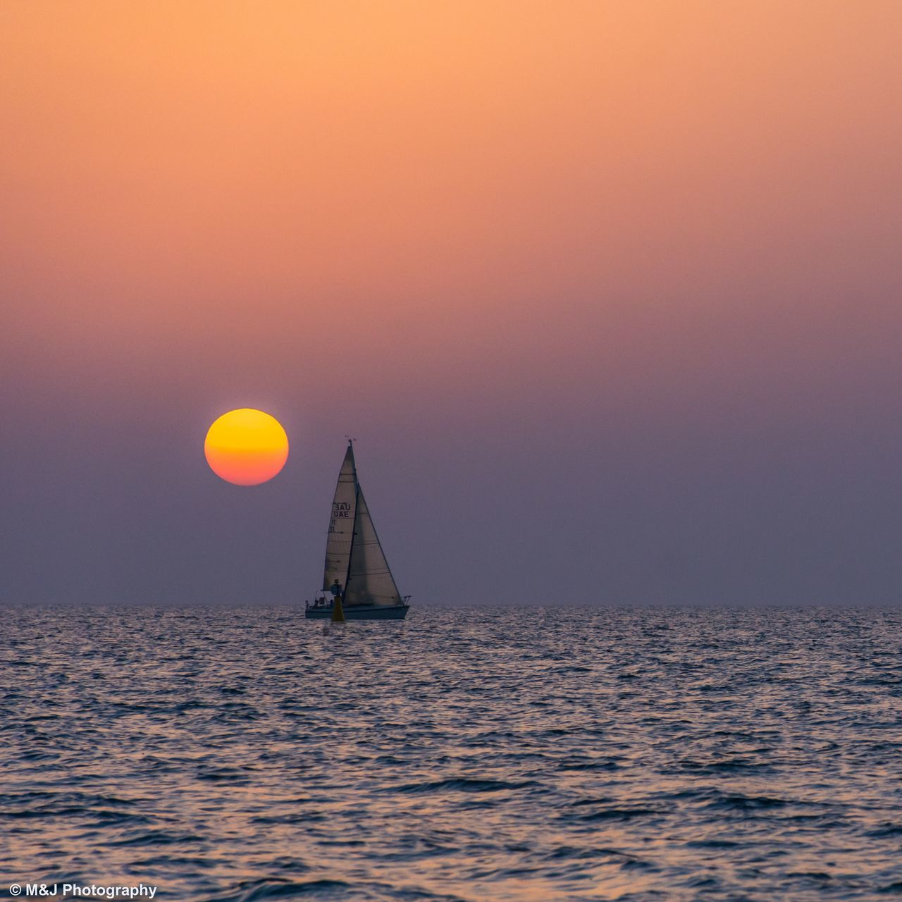 sunset, sea, water, beauty in nature, sun, scenics, horizon over water, nature, tranquil scene, tranquility, orange color, waterfront, idyllic, outdoors, sky, no people, sailboat, transportation, sunlight, nautical vessel, sailing, clear sky, day