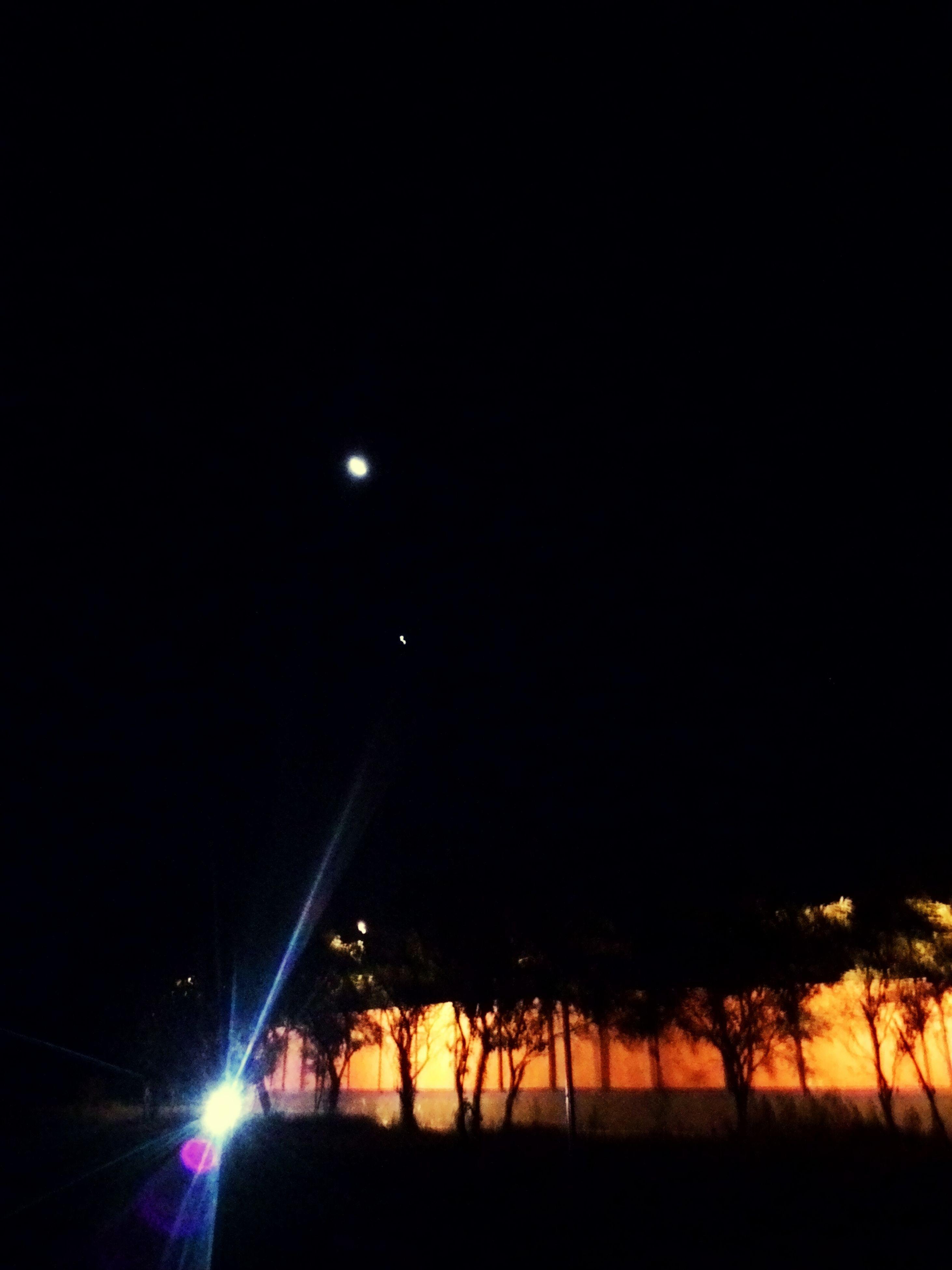 night, illuminated, copy space, dark, silhouette, clear sky, tranquility, moon, tranquil scene, scenics, beauty in nature, nature, street light, sky, glowing, idyllic, lighting equipment, outdoors, tree, light - natural phenomenon