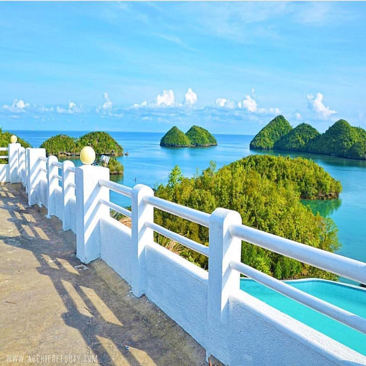 sea, railing, steps and staircases, staircase, steps, scenics, sky, horizon over water, high angle view, tranquility, sunlight, blue, tranquil scene, nature, beauty in nature, water, day, outdoors, no people