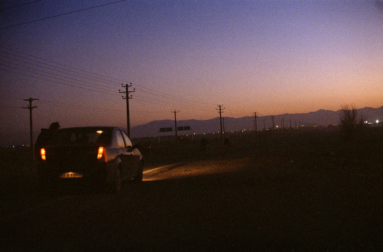 No People Mode Of Transport Transportation Sunset Land Vehicle Night Sky Technology Outdoors Illuminated Nature Road Trip Car People Journey Film Analogue Photography OM1 Iran Desert Night Dusk Color C41 Let's Go. Together.