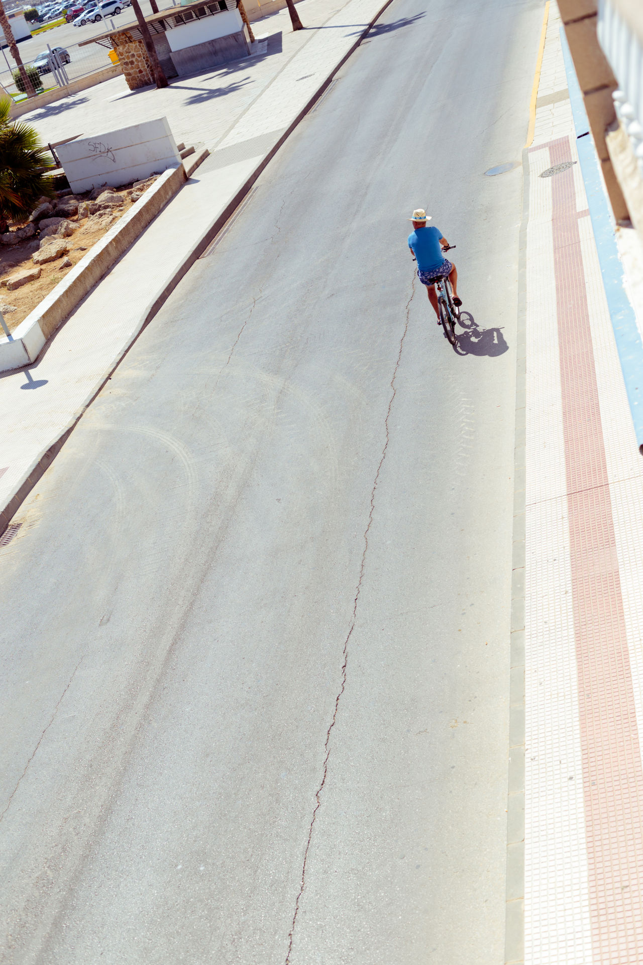 Alone cyclist on the road. Aerial View Bicycle Cycling Day Lifestyle Men Motion Old One Person Outdoors Retro Road Summer Top View Transportation Travel Urban Urban Geometry Vintage Vintage Photo