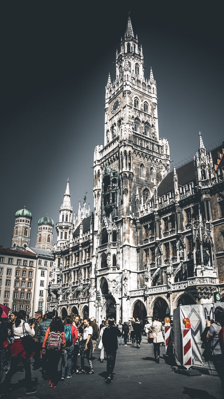 architecture, building exterior, built structure, tourism, real people, travel destinations, history, large group of people, travel, low angle view, outdoors, place of worship, day, spirituality, lifestyles, vacations, men, sky, city, people