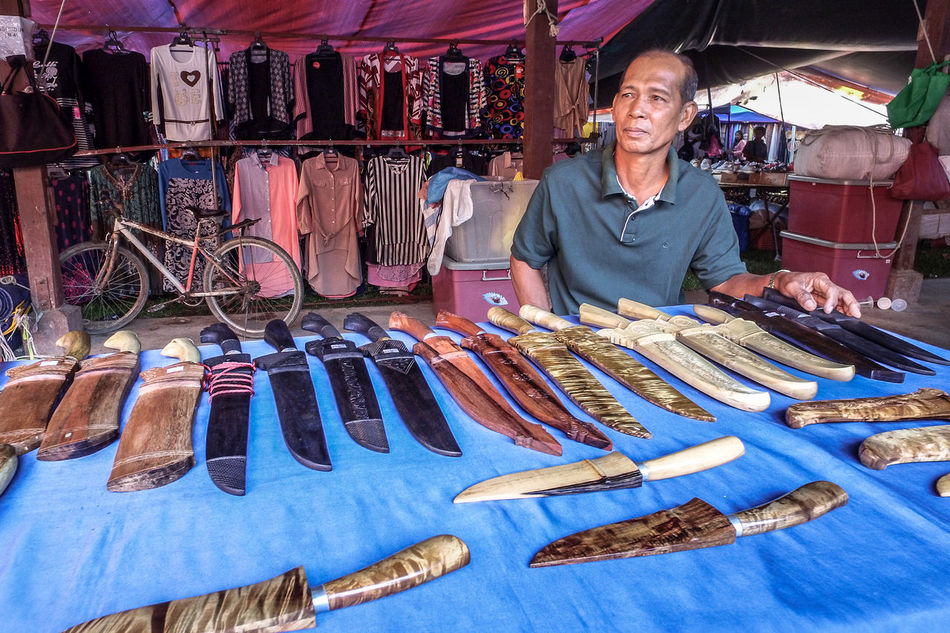 Kota Belud,Sabah-Oct 23,2016:Knives & swords seller at Tamu Kota Belud,Sabah.It is a place where all farmers,fishermen & vendors gathers weekly to sell their products,its a popular tourist destination Attraction Place Destination Knife Kota Belud Local Market Popular Seller Swords Tamu