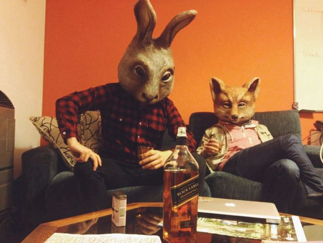Drinks Whiskey with friends