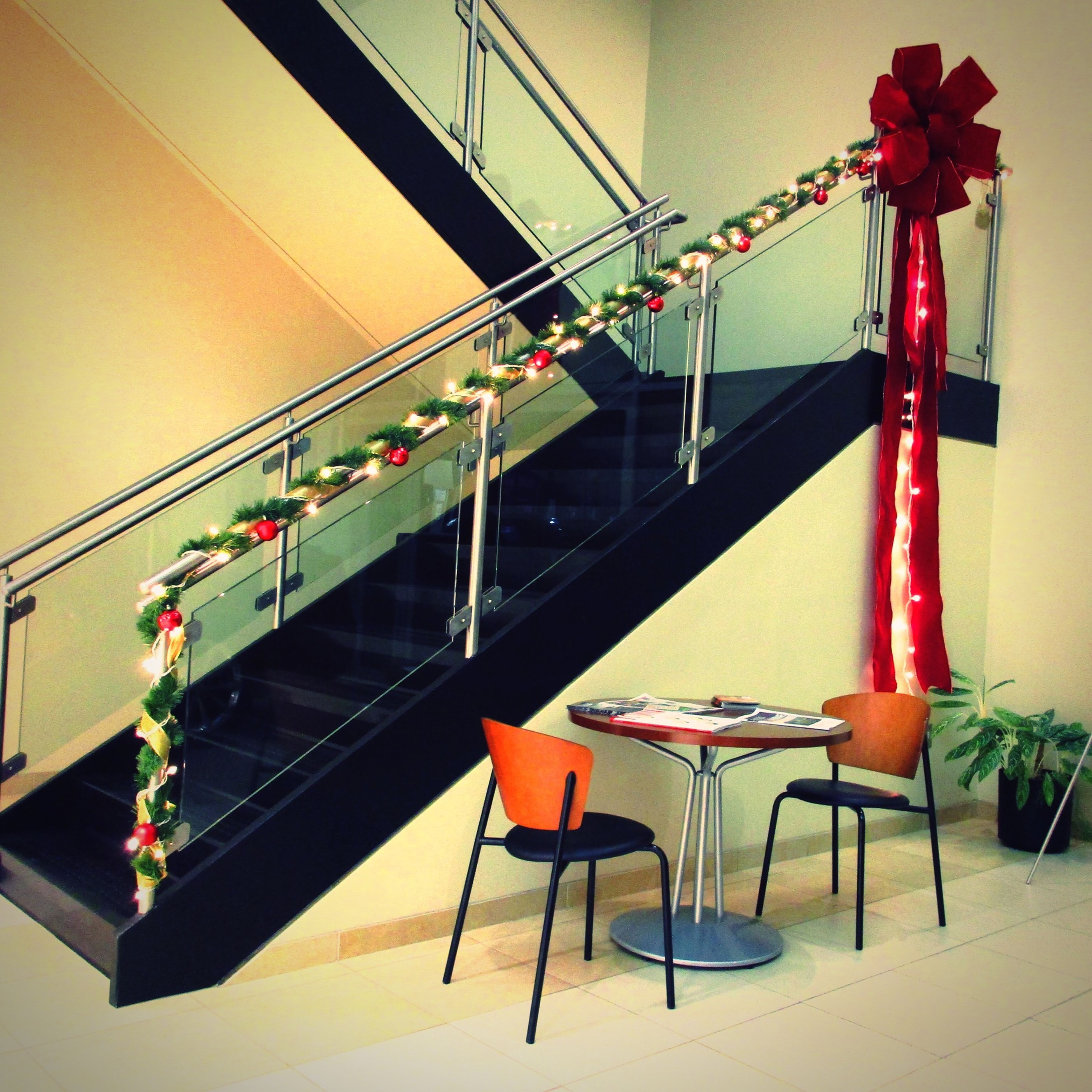 indoors, absence, chair, empty, steps, steps and staircases, railing, staircase, seat, built structure, ceiling, architecture, no people, furniture, low angle view, hanging, flooring, metal, wall - building feature, table