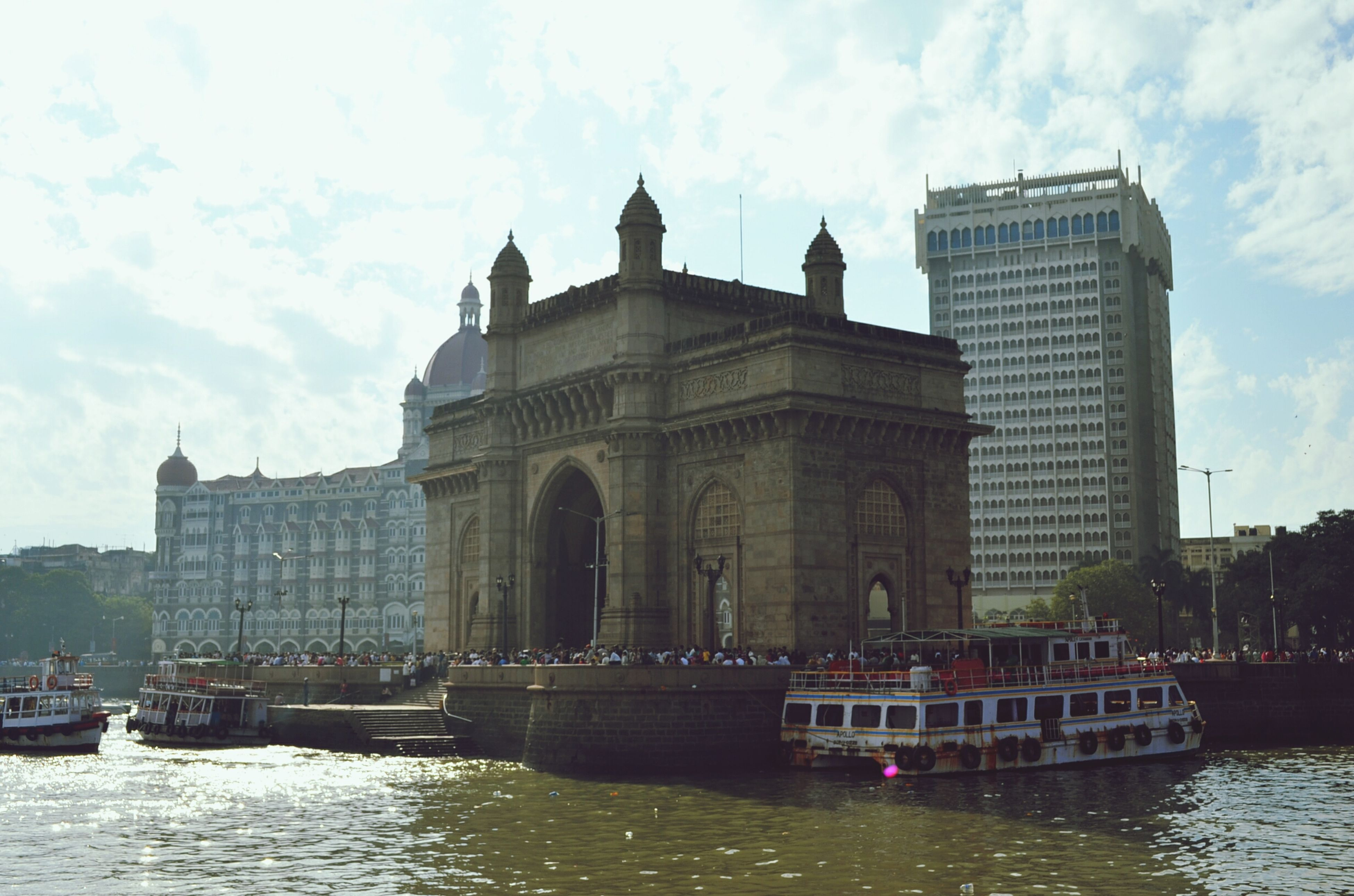 architecture, building exterior, built structure, water, waterfront, sky, transportation, nautical vessel, mode of transport, river, travel, boat, travel destinations, cloud - sky, famous place, city, incidental people, canal, tourism, history