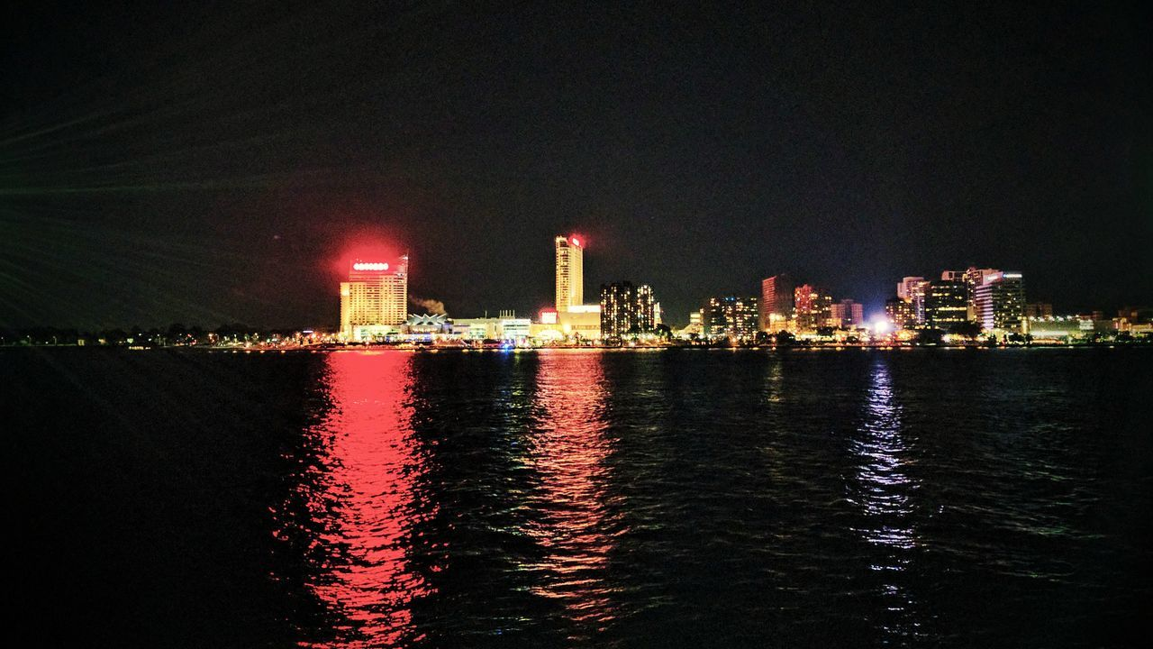 night, illuminated, building exterior, architecture, built structure, waterfront, reflection, water, sky, no people, outdoors, city, sea, skyscraper, travel destinations, cityscape, urban skyline, nature