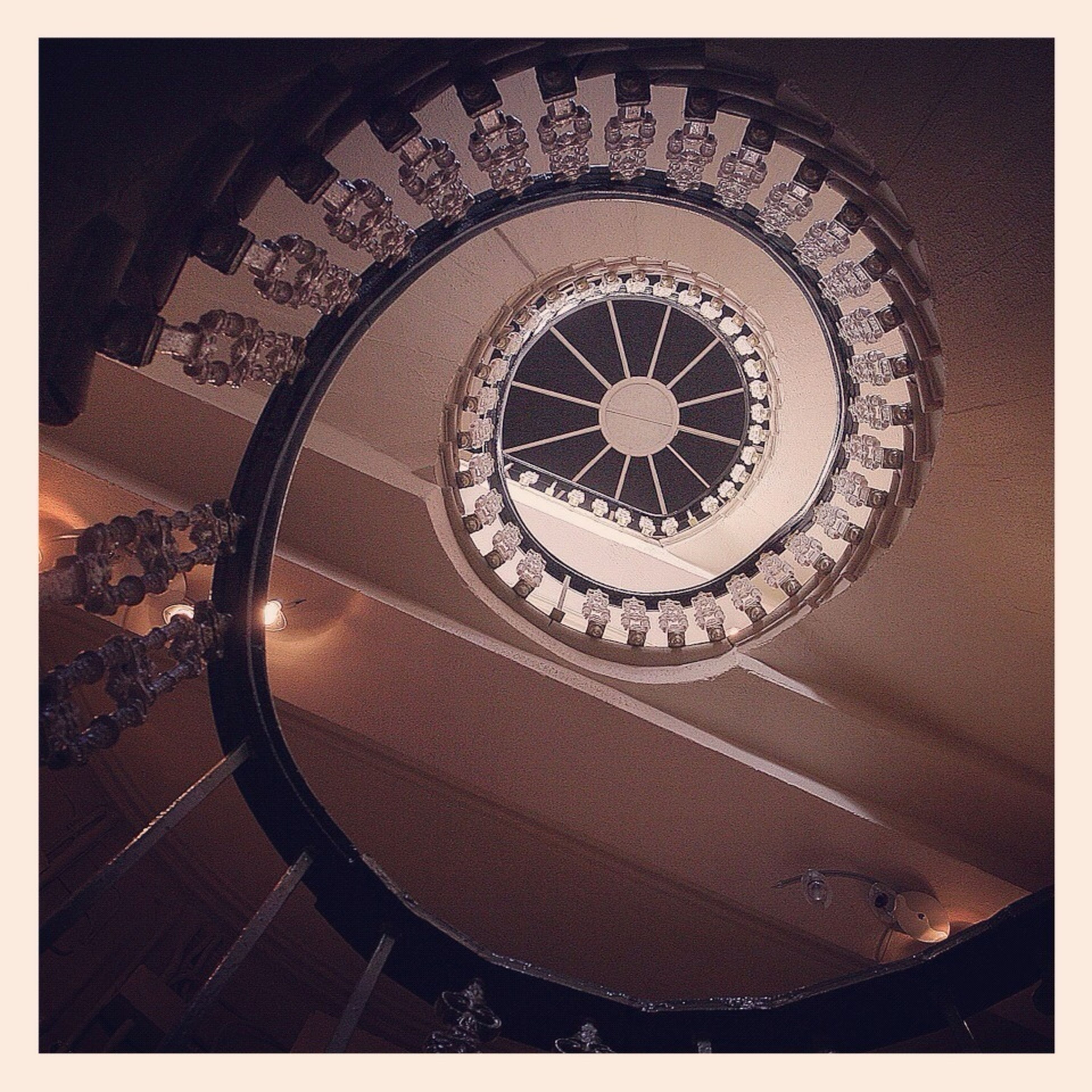 transfer print, indoors, auto post production filter, circle, built structure, architecture, steps, spiral staircase, steps and staircases, pattern, staircase, geometric shape, spiral, low angle view, railing, no people, design, directly below, day, high angle view