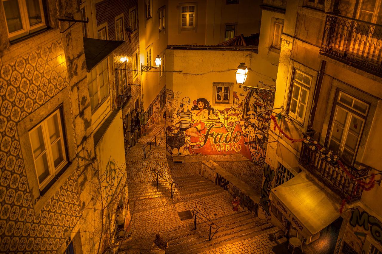 Escadinhas de São Cristóvão, Lisbon, Portugal Architecture Artists Arts Escadinhas Escadinhas De São Cristóvão Fadista Fado Grafiti Art Grafitti Illuminated Lisbon Lisbonlovers Neighborhood Night No People Painting Portugal Public Saint Christopher Staircase Steps And Staircases São Cristóvão