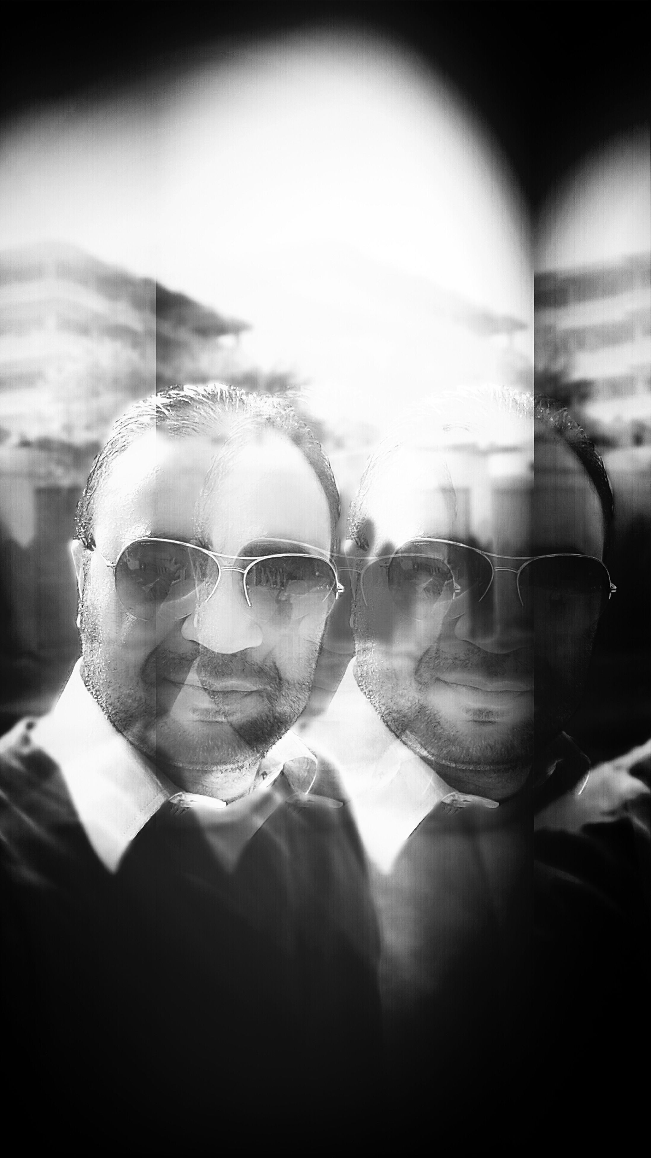 transparent, lifestyles, glass - material, indoors, leisure activity, headshot, sunglasses, reflection, head and shoulders, young adult, person, close-up, window, portrait, front view, glass, looking at camera, young men