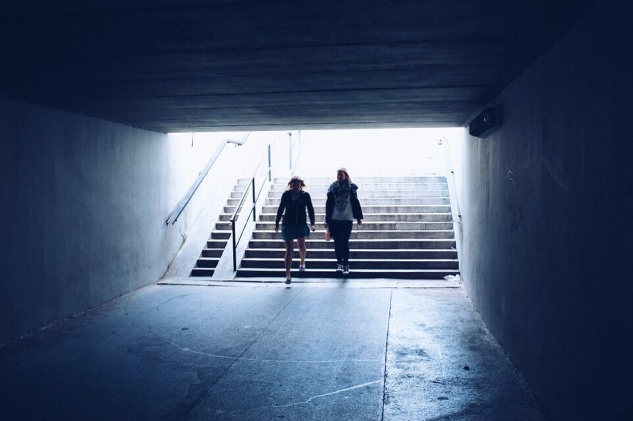 staircase, walking, full length, steps and staircases, indoors, steps, real people, architecture, built structure, togetherness, the way forward, two people, day, lifestyles, men, women, friendship, young adult, adult, people, adults only