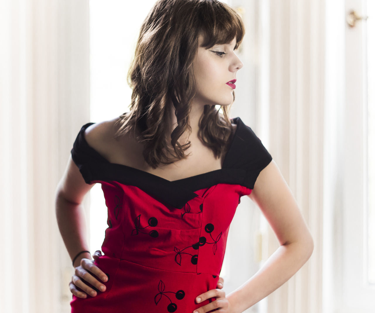 Adult Beautiful People Beautiful Woman Beauty Black And Red Black Dress Fashion Girl Hands On Hips Natural Light Natural Light Portrait One Person One Woman Only One Young Woman Only Pin Up Portrait Red Red Dress Standing Window Young Adult Young Women