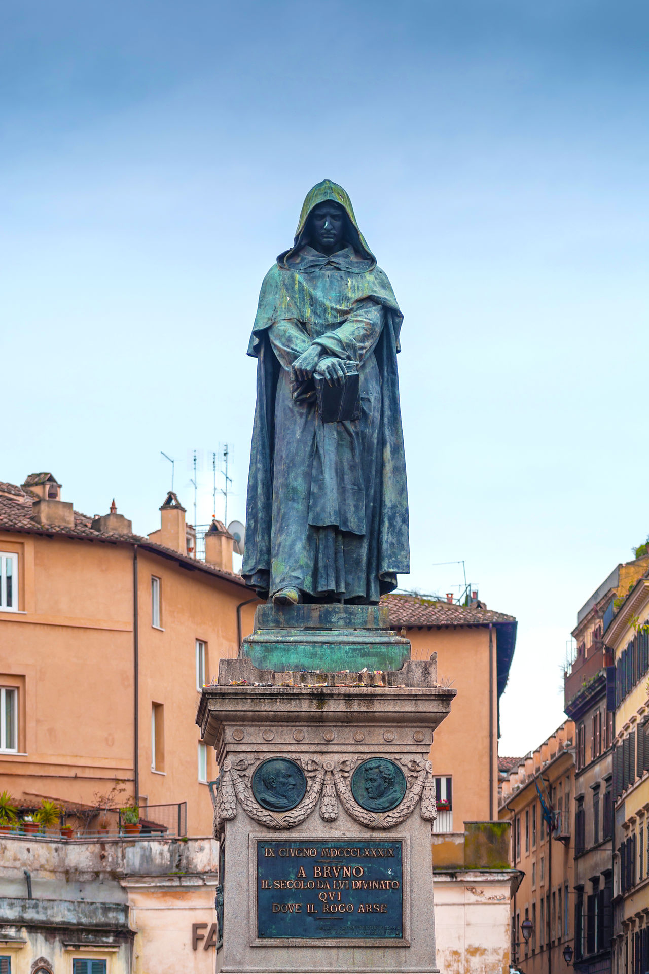 Giordano Bruno was an Italian Dominican friar, philosopher, mathematician, poet, and astrologer.He is celebrated for his cosmological theories, which went even further than the then novel Copernican model Architecture Art Blue Built Structure Campo De' Fiori Capital Cities  City Creativity Day Famous Place Giordano Bruno Heretic Low Angle View No People Outdoors Rome Sculpture Sky Statue Tourism Travel Destinations