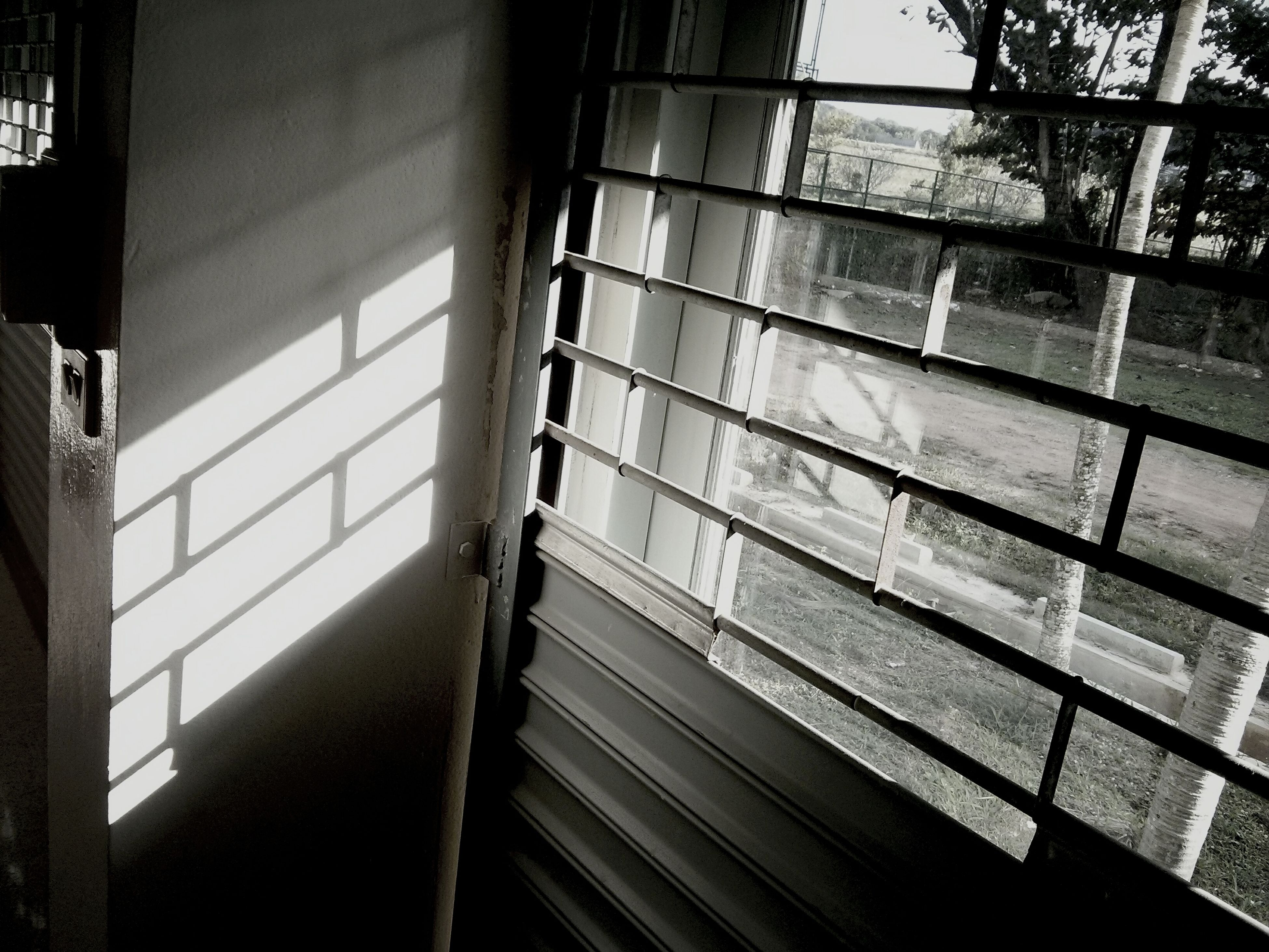 indoors, window, architecture, built structure, glass - material, railing, transparent, metal, building, steps, day, reflection, staircase, building exterior, empty, sunlight, no people, absence, ceiling, interior