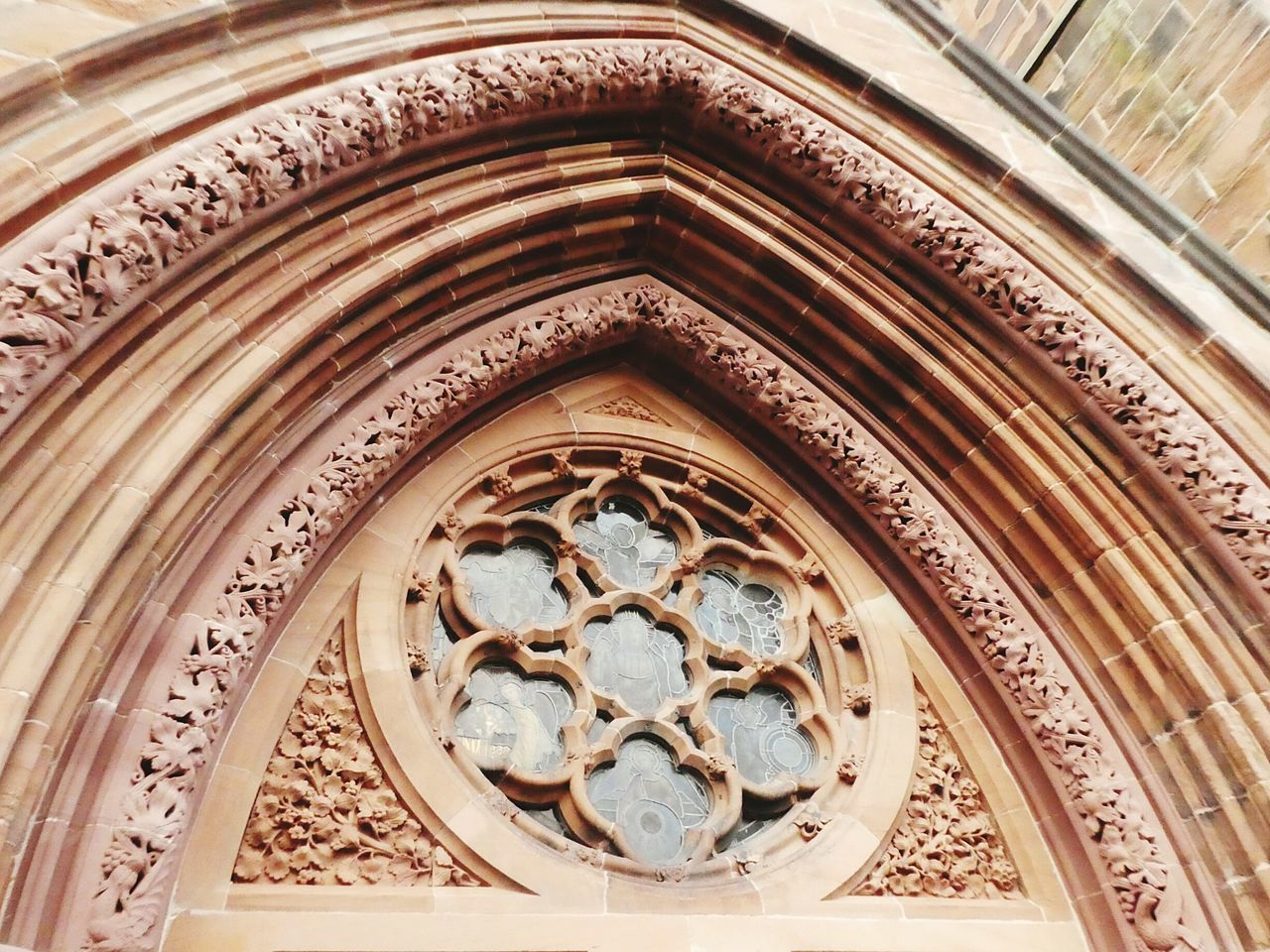 Carlislecathedral Beautiful Carved Stone Arch Stained Glass Window Red Sandstone Medieval Architecture No People 1122AD Built Structure Low Angle View Heritage Site Stone Carving Medieval Church Historical Architecture Building Exterior Detailed To Perfection Wonderful History