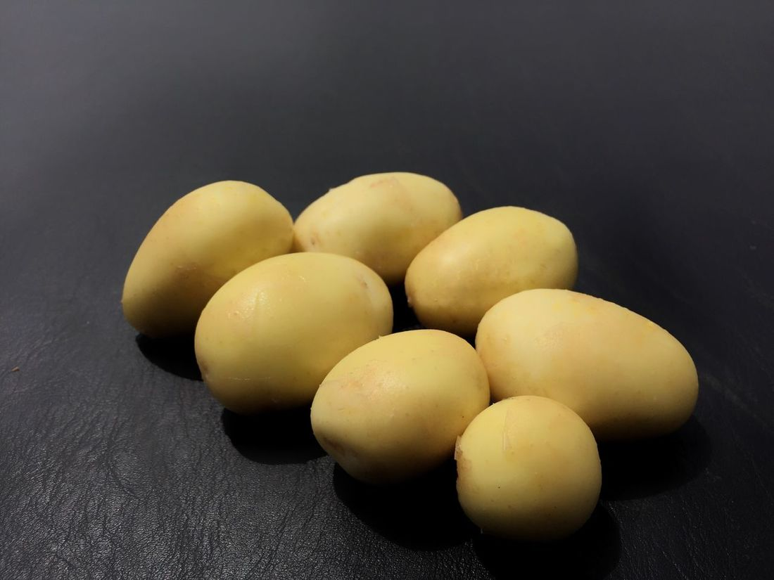 Yellow potatoes presented for personal perlustration. Potatoes White Potatoes Black Background Food Still Life Food And Drink Healthy Eating Close-up Freshness Table No People Indoors  Day Yellow Potatoes