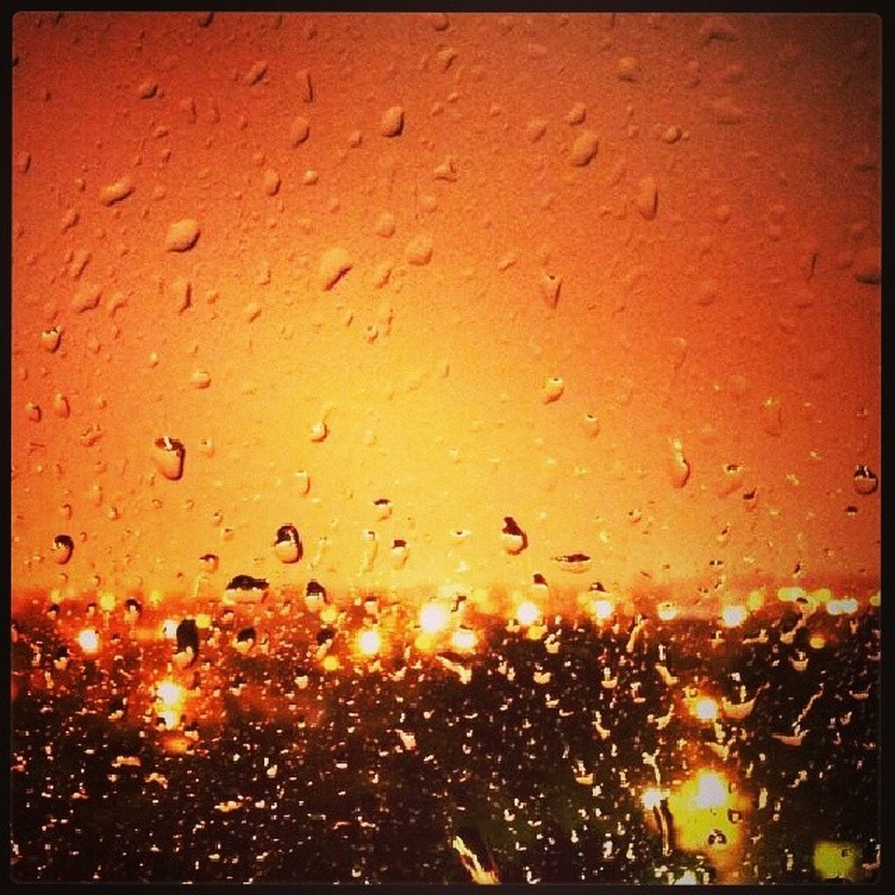 drop, backgrounds, full frame, wet, window, no people, orange color, close-up, water, condensation, raindrop, indoors, illuminated, nature, night, sky, freshness