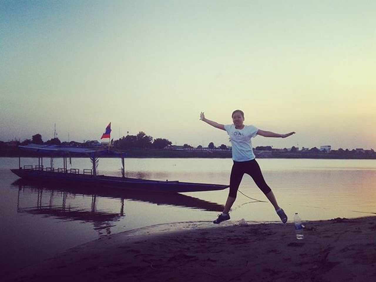 Fun Funatthemekong Flying Starjumps Exercise Sexylaogirl SexyAsian Sunsetonthemekong River Boat Shadow Silhouette Vientiane Laos Southeastasia Lifeasiseeit Johnnelson