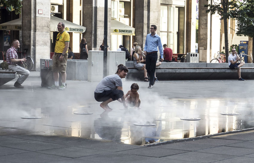 #Child #Mom  #Moment #em5markii #europe #fontana #fountain #hungary #olympus #omd #spray #streetphoto #streetphotography #travel #wet Budapest Architecture Built Structure City Day People Real People Street