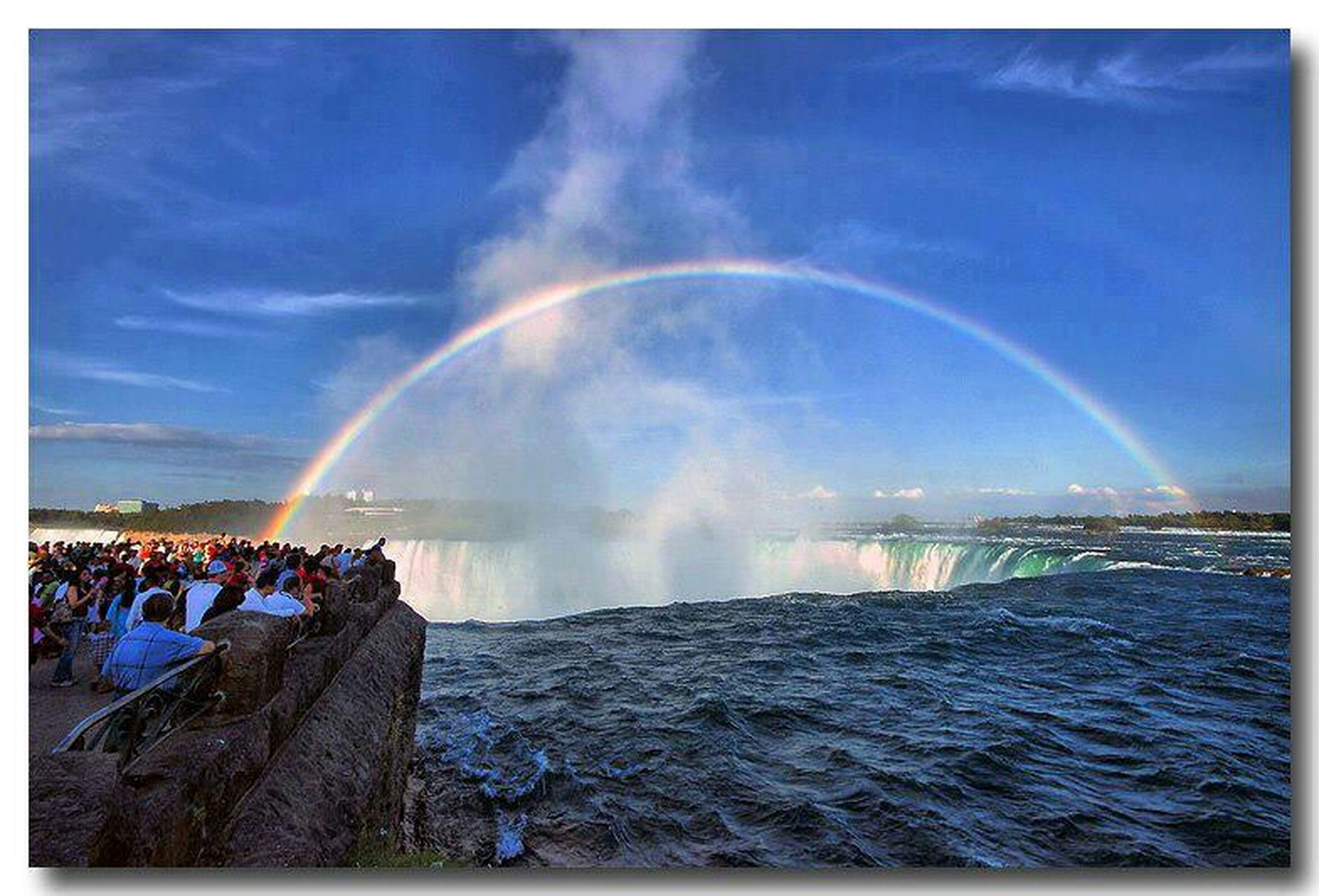 water, sky, transfer print, blue, motion, spraying, sea, built structure, splashing, fountain, rainbow, auto post production filter, architecture, beauty in nature, scenics, nature, waterfront, building exterior, cloud - sky, travel destinations