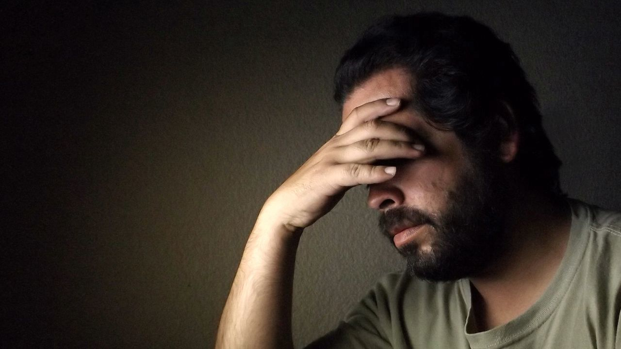 Disappointed Man Against Wall At Home