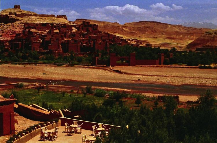 Moroccan Filmset Architecture Arid Climate Beauty In Nature Blue Sky White Clouds Built Structure Composition Dry Climate Filmset Landscape Marrakesh Morocco Mud Brick Buildings No People Outdoor Photography Red Colour River Scenics Tourist Attraction  Tourist Destination Traditional Building Tree