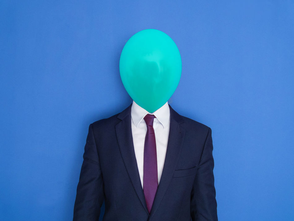 Portrait of a elegant businessman in a suit with a head replaced by a balloon. Lightheaded man. Adult Adults Only Balloon Balloon Head Banking Blue Boss Buffoon Business Dresscode  Economic Crisis Elegant Funny Headshot Liar Male Manager Mask One Person People People Photography Portrait Poser Surrealism Tie
