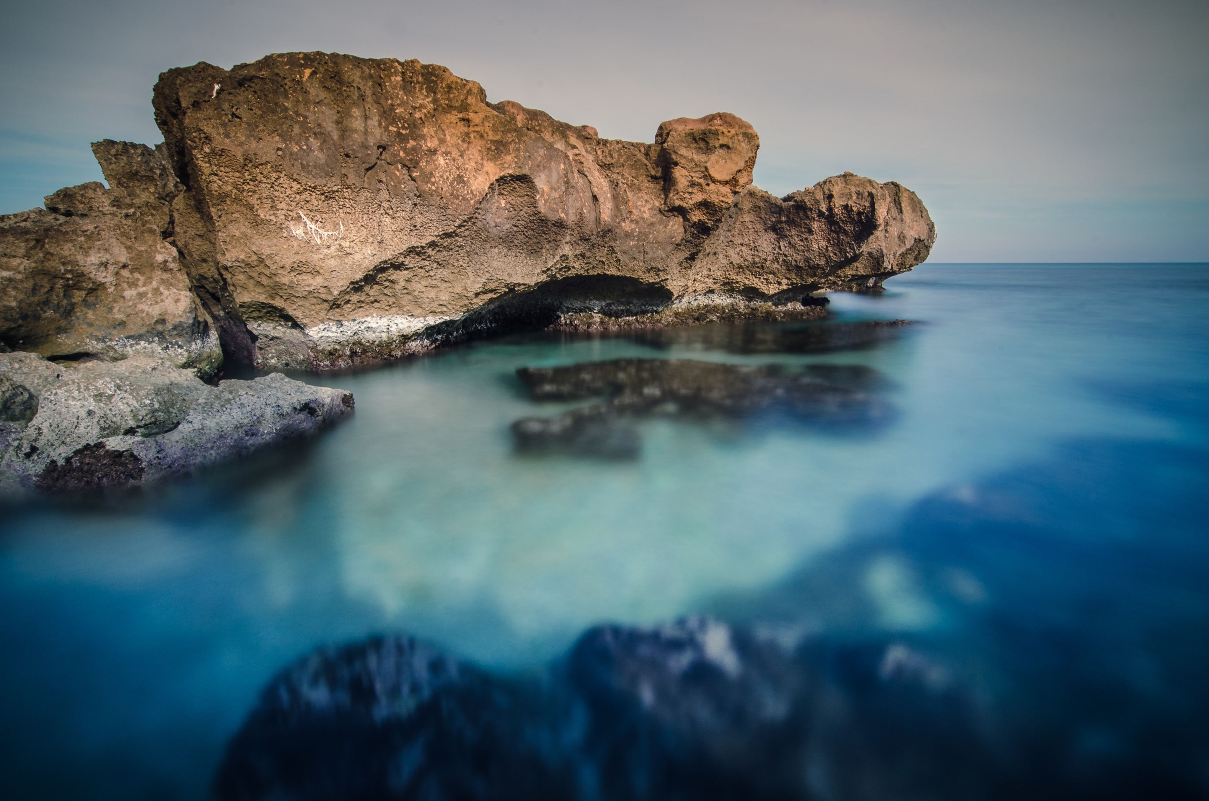 water, sea, rock - object, rock formation, beauty in nature, scenics, tranquil scene, tranquility, nature, sky, rock, horizon over water, beach, idyllic, cliff, geology, outdoors, reflection, shore, eroded
