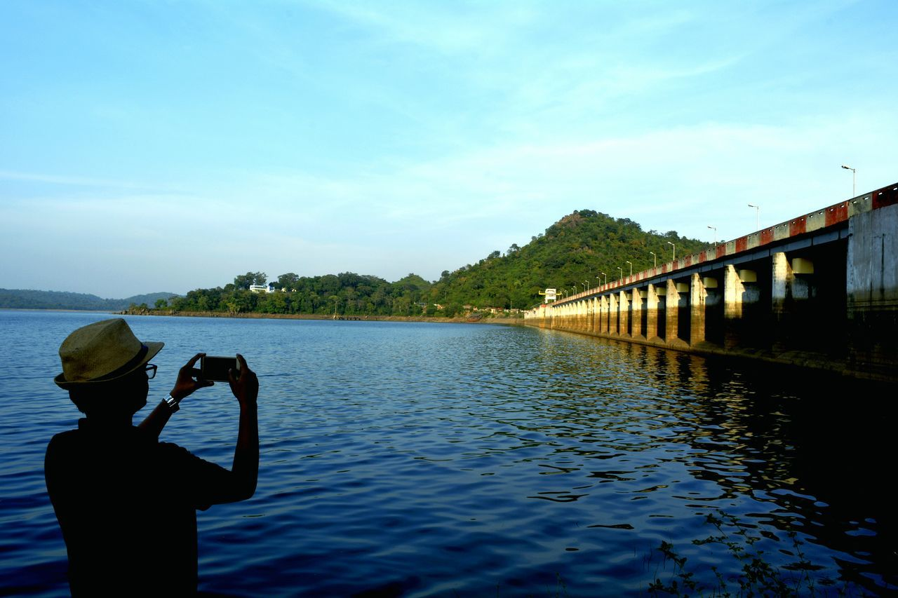 Masanjor dam at jharkhand Photography Themes Photographing Water Technology Wireless Technology One Person Camera - Photographic Equipment Sky Outdoors People Nature Day Adult Adults Only Dam Lake Human Body Part Week On Eyeem Photo Of The Week Landscape