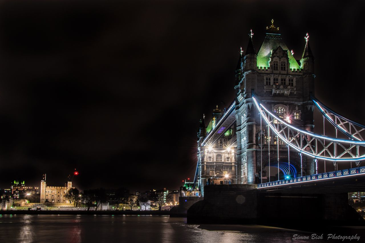 architecture, illuminated, night, built structure, travel destinations, building exterior, tourism, travel, river, waterfront, bridge - man made structure, sky, water, city, no people, outdoors