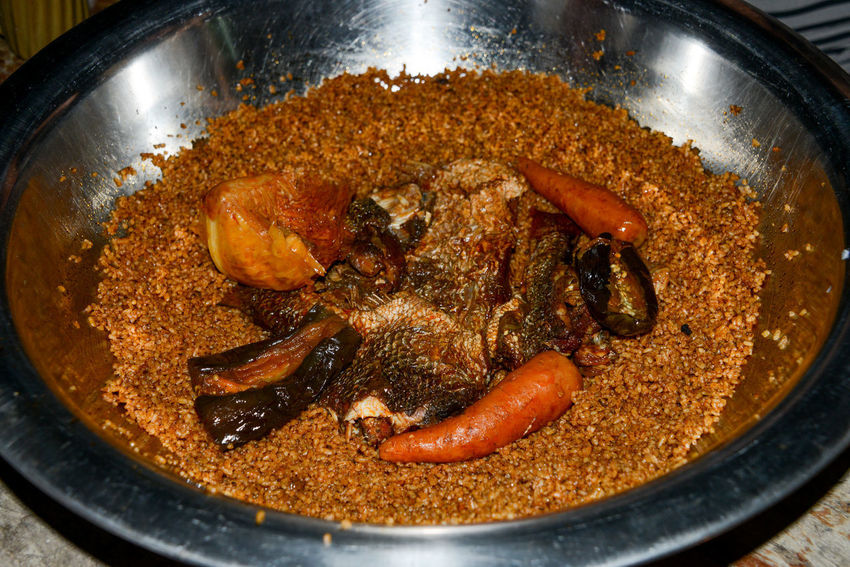 Senegalese national dish Thieboudienne African Food Eggplant Niafarang Niafourang Niafrang Rice West Africa Africa Carrot Casamance Close-up Fish Food Food And Drink Kitchen National Dish No People Palmoil Preparation  Ready-to-eat Senegal Senegal Food Thieboudienne