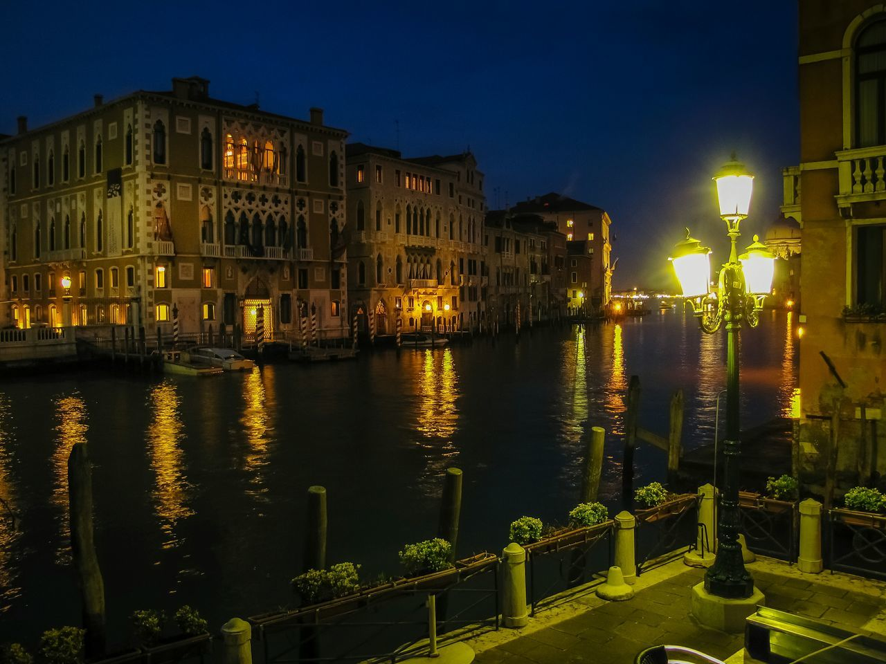 building exterior, architecture, night, illuminated, built structure, outdoors, water, no people, sky, city