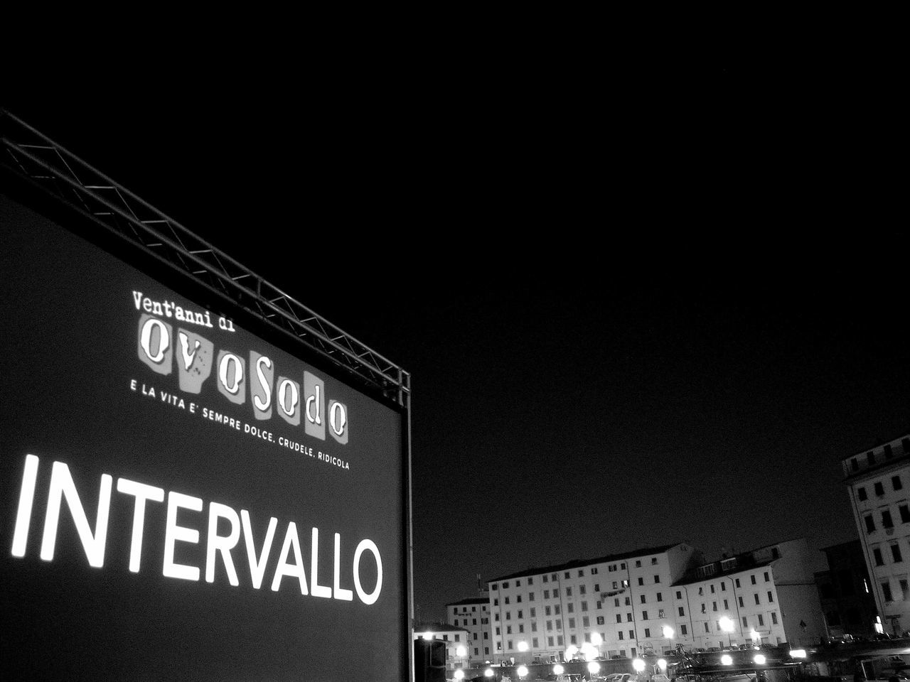 Night Illuminated Text Architecture Built Structure Communication Building Exterior No People Proiection Anniversary Film Low Angle View Cinema Black And White Photography City Outdoors una città sospesa