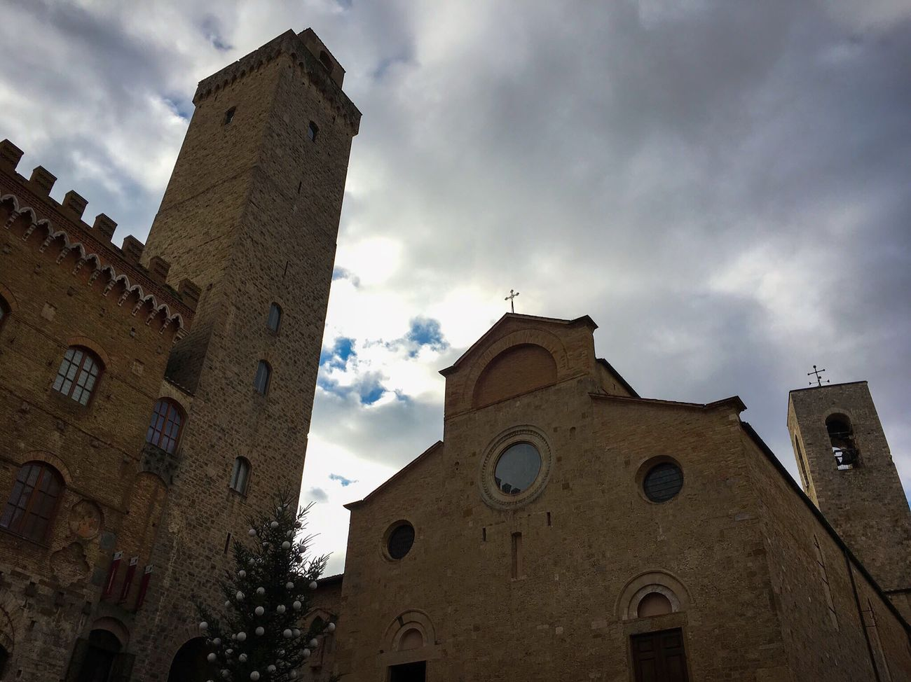 San Gimignano Sky Building Exterior Low Angle View Cloud - Sky Religion Spirituality Church Spiritual No People Christmas Tree Christmastime Italia Architecture Historical Building Light And Shadow Traveling Travel Travel Photography Travelphotography Light And Shadows Streetphotography Italy Toscana Tuscany