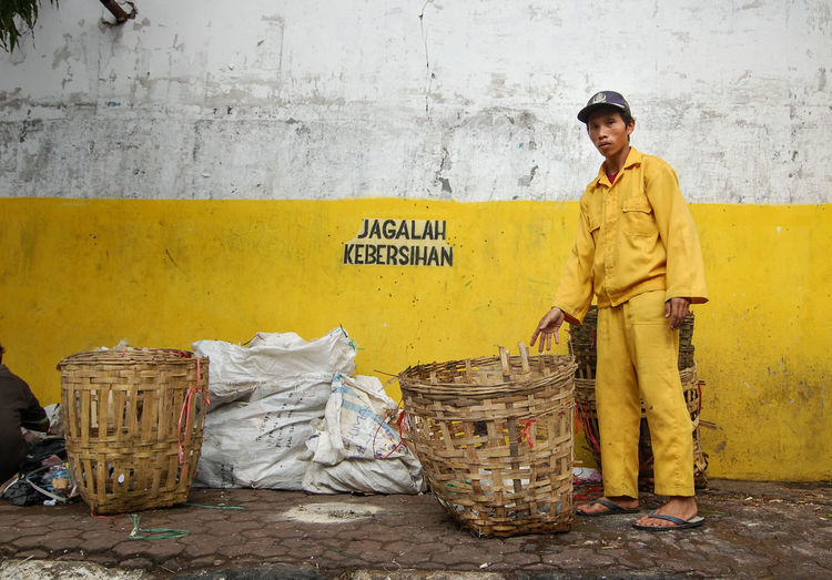 Cleaning person in Malang taking care of trash bin, usually called The Yellow Army. Cleaning Cleaning Equipment Yellow Yellow Army Pasukan Kuning INDONESIA Indonesia_photography Yellow Wall Adult Occupation Occupation, Profession, Trade, Position, Career, Work, Line Of Work, Livelihood, Malang, Indonesia Malang Cleaning Clean Environment Environmental Protection